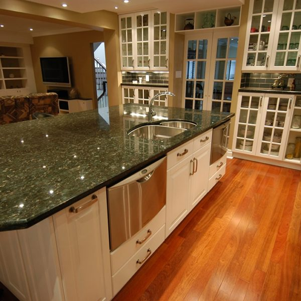 Ample-Kitchen-With-White-Cabinetry-And-Granite-Countertop