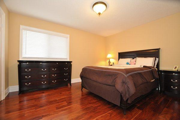 Bedroom-With-Wooden-Floors-Custom-Home-Builder