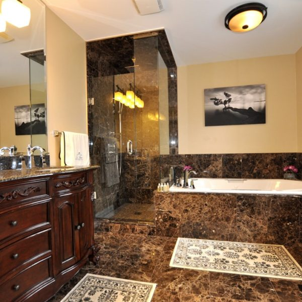 Black-Granite-Tile-Bathroom-With-Bathtub-And-Glass-Enclosed-Shower