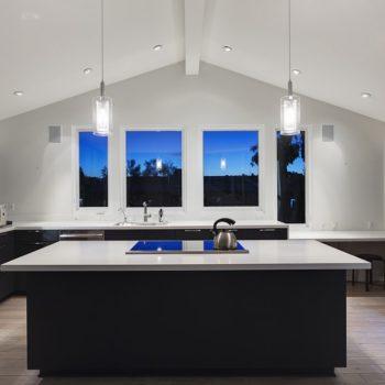 Dark-Wooden-Kitchen-Cabinets-With-Contrasting-White-Quartz-Countertops