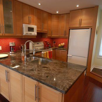 Granite-Countertop-And-Red-Tiled-Backsplash