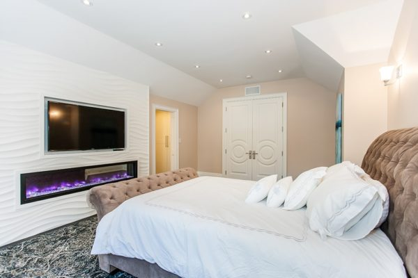 Guest-Bedroom-with-Wood-Panlling-&-Gas-Fireplace
