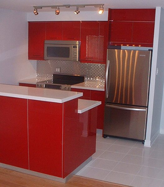 Red-Funky-Kitchen-With-Stainless-Steel-Appliances