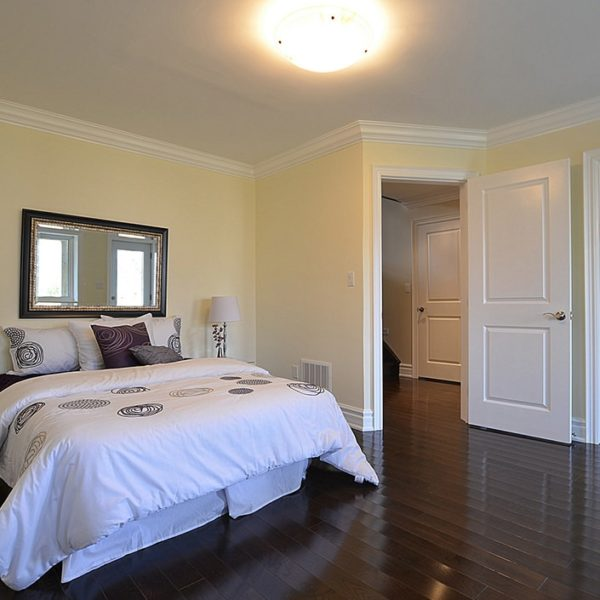 Spacious-Guest-Bedroom-With-Cherry-Wood-Floors