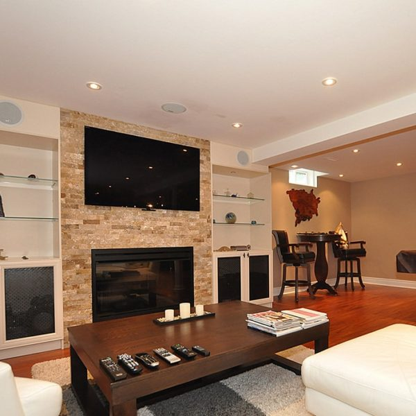 Wall-Unit-With-Stone-Fireplace-In-Basement