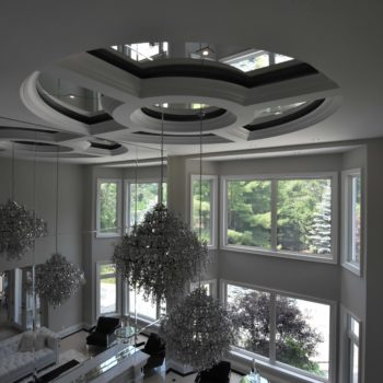 Home glass ceiling and crystal chandelier - Custom homes and Complete renovation by Maki Construction in Mississauga