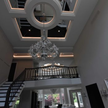 Home glass ceiling and interior staircase - Custom homes and Complete renovation by Maki Construction in Mississauga