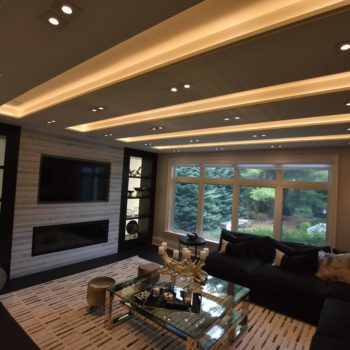 Fireplace and Smart T.V in Family room with LED ceiling (Side view) - Custom homes and Complete renovation by Maki Construction in Mississauga
